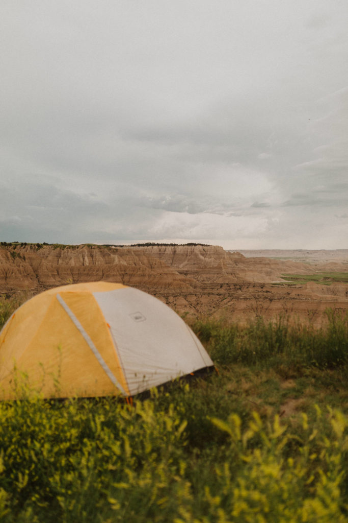 Camping in the Badlands, Badlands National Park, Badlands Elopement, yellow tent, Black Hills Elopement, Black Hills wedding Venue
